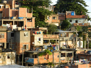 In the 'pacified' Brazilian shantytowns where drugs gangs have been expelled by police, tin roofs and spliced electric wires are being replaced by brick and mortar buildings, power and sewage infrastructure.